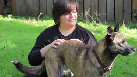 large breed dog : young woman scratching dog