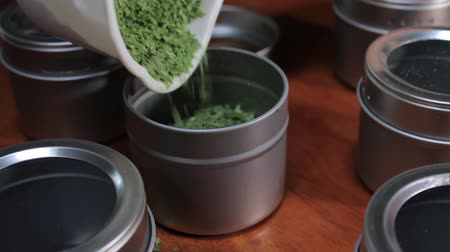 arrumado : filling a basil container Stock Footage