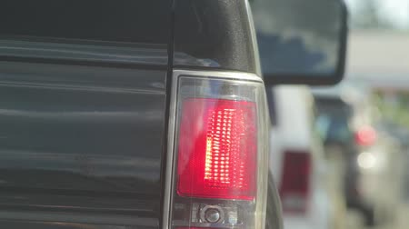 brake : close up of the tail lights of a veicle at a stop light Stock Footage