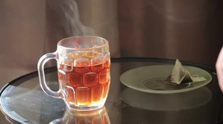 acorde : steaping tea bag on a glass table Stock Footage