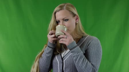 scalded : Young woman scalded by hot tea. The girl has sensitive teeth. Stock Footage