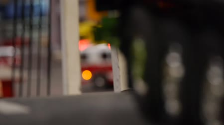lojistik : Truck crossing the bridge, close up, fire truck in the background - unfocused style of the camera Stok Video