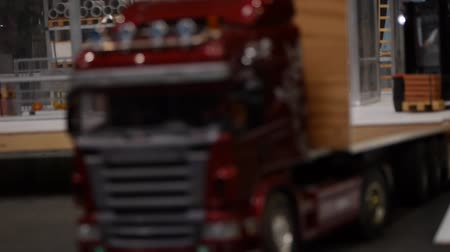 lojistik : Logistics business and shipping facility - Forklifts loading goods on Truck - unfocused style of the camera - miniature car models Stok Video