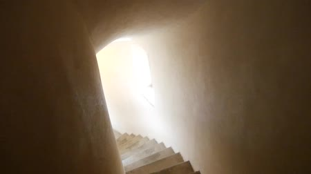 crypt : Walking down the stairs in the old castle tower. Medieval castle corridors.