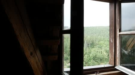 sombrio : Open the window in an old wooden house.