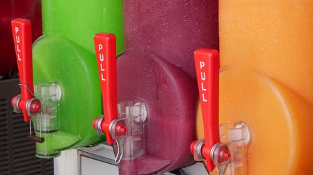 taneli : Freezing and mixing machine for the production of cold ice slush fruit juice. Different flavors in many colors.