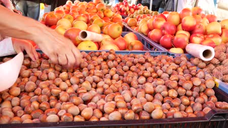 hazelnuts : Farmers food market stall with a variety of organic fruit for example, hazelnuts, walnuts and apples.