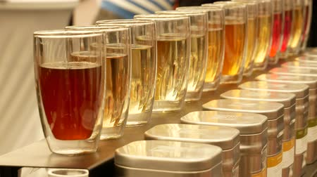 various tea : Tasting of teas. Glass cups with different types of tea and ingredients.