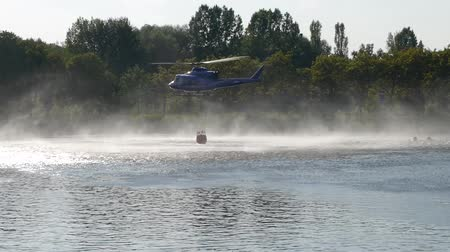 The fire brigade rescue helicopter carries water in the tank.