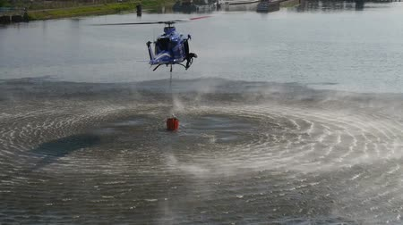 bombeiro : Emergency propeller helicopter in the air with water for extinguish danger fire.