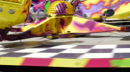 Very fast carousel in motion, in an amusement park. Adrenaline fun from overload.