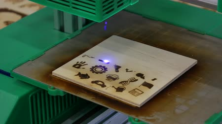 3D laser printing, burning drawings into a wooden board