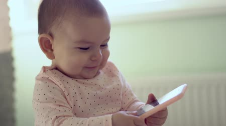baby sitter toddler using holding phone future generation early development concept