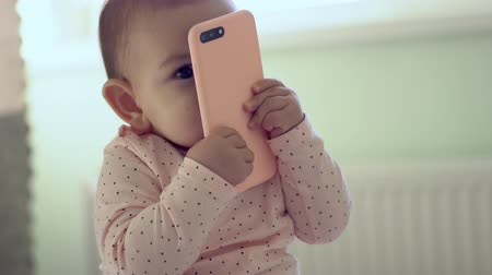 denemek : baby sitter toddler using holding phone future generation early development concept