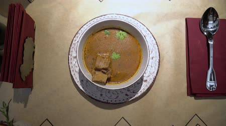 Bowl of Hot Georgian Soup Kharcho with Meat in restaurant top