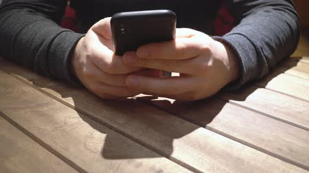 closeup of hands of a young man texting in messegner on the smartphone 4k