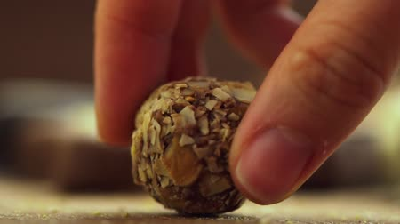 íz : Hand made chocolate candies falling on wooden background, tasty sweets in slow motion uhd