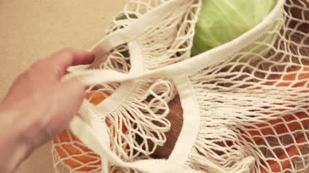 biodegradable : Recycling mesh string bag full of vegetables and fruits, eco frindly no plastic concept 4k
