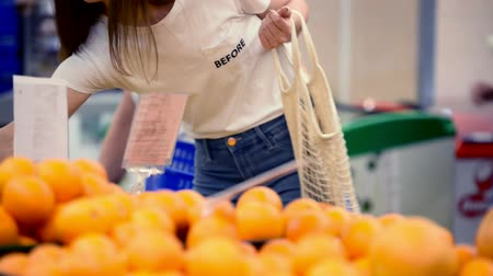 mesh : pretty girl woman picking veggies and fruits in supernarket in mesh organic shopping bag, zero waste , eco friendly