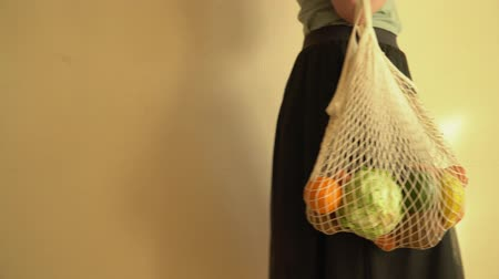 çuval : Recycling mesh string bag full of vegetables and fruits, eco frindly no plastic concept 4k