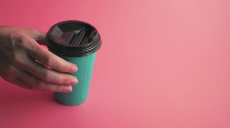 lids : Paper cups on pink background, turquoise color, copy space 4k Stock Footage