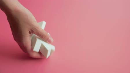 alaplap : Sponge for cleaning face falling in slow motion on pink backgground