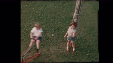 Kids on backyard Whirligig  High angle 1957 Dostupné videozáznamy