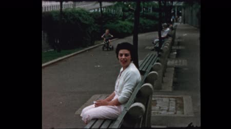 1957 Little boy on Tricycle stops to give mother a kiss in NYC park Dostupné videozáznamy