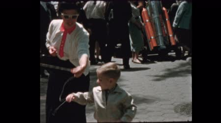 Mom gives cute little boy balloon at the Zoo 1957