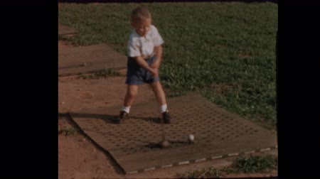 Little boy tees off at Golf Driving Range 1957