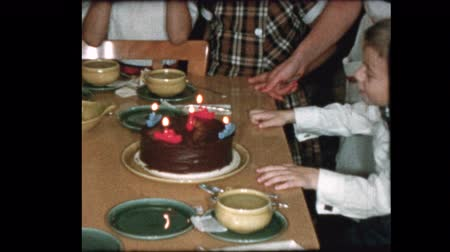 szentimentális : 5 year old blows out birthday candles and family sings Happy Birthday to you
