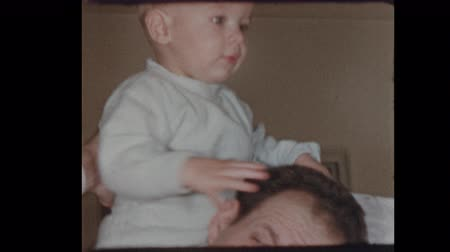 50s dad with baby boy on shoulders 1953