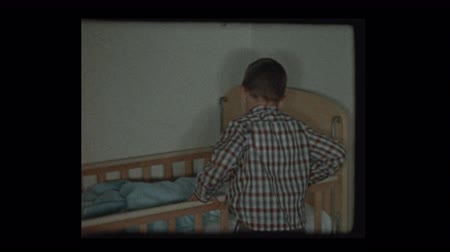 sentimentální : 7 year old boy sees newborn baby brother in crib for the 1st time 1959