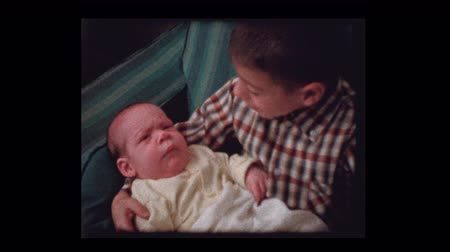 bonds : 7 year old boy lovingly holds infant baby brother 1959