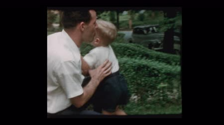 zapasy : 1955 50s dad and son play fighting, box and rough house