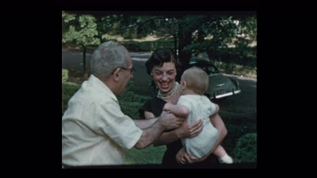 Glam 50s mom baby and grandfather coax baby to come to him 1953