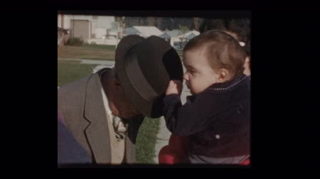 1960 Baby boy plays with grandfathers hat Dostupné videozáznamy