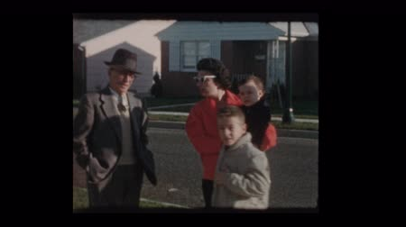 1960 Family with baby chatting on suburban street Dostupné videozáznamy