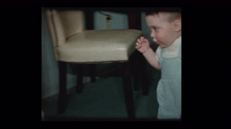 unbalanced : 1960 Baby boy learns to walk with help of older brother Stock Footage