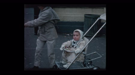 Big brother and Little boy in stroller with pink balloon 1960