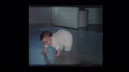 szentimentális : Happy baby boy crawling around slippery tile floor 1961