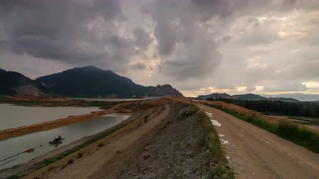 hydro : Timelapse cloudy day high angle Mengkuang dam during sunset. Stock Footage