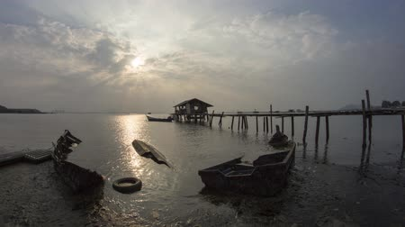 pleasure boats : Time lapse ray at abandoned traditional fishing boat at fisherman broken hut at Jelutong Highway, Penang, Malaysia, Southeast Asia. Stock Footage