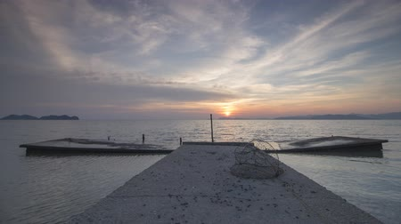 mole : Timelapse beautiful sunset at fisherman jetty without boat at Juru, Penang, Southeast Asia. Stock Footage