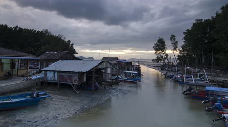 fender : Timelapse sunset cloudy day at fishing village, Penang, Malaysia.