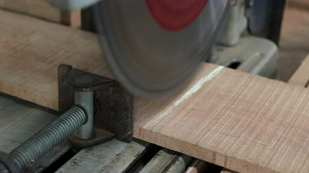 miter saw : Compound miter saw cutting a piece of wood in carpentry workshop