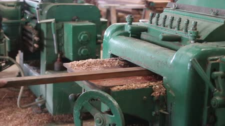 meubelmaker : Worker is working with electric planer of wood machine.