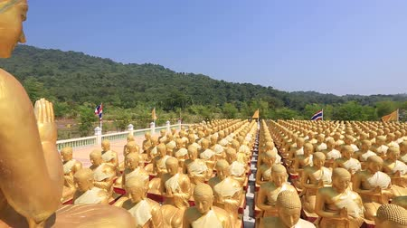 szerzetes : Golden Buddha is the Buddha Memorial Park (MakhaBucha), Nakornnayok, Thailand, HD 1080P.