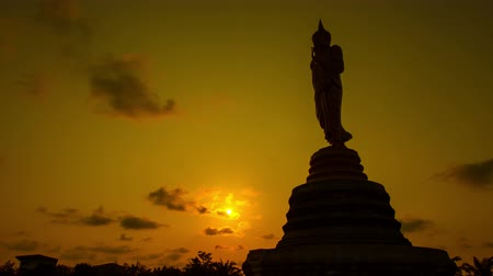 heykel : Buddha gold and clouds sky evening .4 k timelapse.