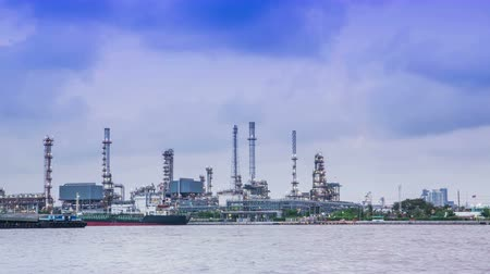 greenpeace : Oil refinery on the river and waterways. 4K timelapse Stock Footage